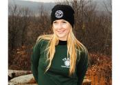 Black Knit Hat and Green Long Sleeve Shirt